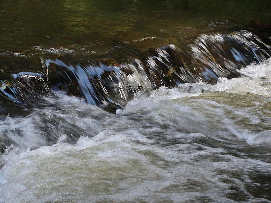 Water Flowing over rocks in river