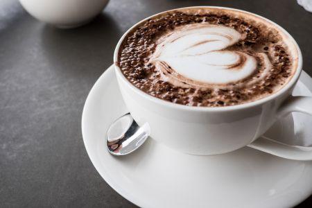 vecteezy_heart-shape-latte-art-on-top-of-coffee-cup